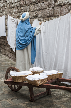 GUBBIO, ITALY - 08 DECEMBER 2017 - A visit to the beautiful medieval town of Umbria Region, during the Christmas holidays, with the nativity scenes of life-size statues in San Martino district - Italy