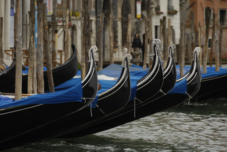 Gondolas moored in a typical Venetian canal - Venice, Italy