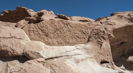 Ancient Petroglyphs on the Rocks at Yerbas Buenas in the Atacama Desert in Chile Stock Photo