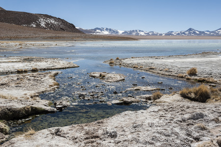 Laguna y Termas de Polques hot spring pool with Salar de Chalviri in the background, Salar de Uyuni, Potosi, Bolivia - South America
