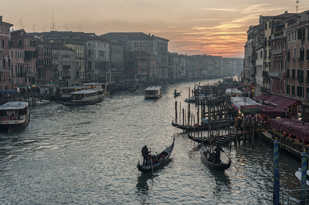 VENICE - ITALY, DECEMBER 29, 2018: Famous picturesque romantic Venetian Grand Canal at the sunset, Venice - Italy