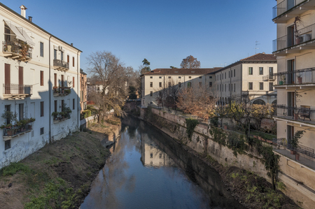 View from San Michele Bridge, ancient stone bridge in the historic city center - Vicenza, Italy