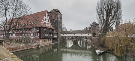 The famous Former Wine Depot (Weinstadel) and Water Tower (Wasserturm) over the river Pegnitz seen from Maxbr?cke - Nuremberg Germany