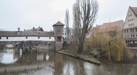 The famous Former Wine Depot (Weinstadel) and Water Tower (Wasserturm) over the river Pegnitz and Henkersteg and Henkerhaus seen from Maxbrcke - Nuremberg, Germany Zdjęcie Seryjne