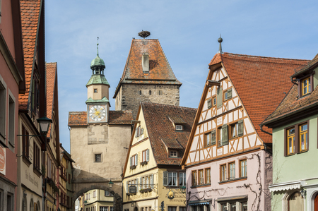 Markus Tower (Markusturm) and traditional German houses on the Rodergasse street, Rothenburg ob der Tauber, one of the most beautiful and romantic villages in Europe, Germany