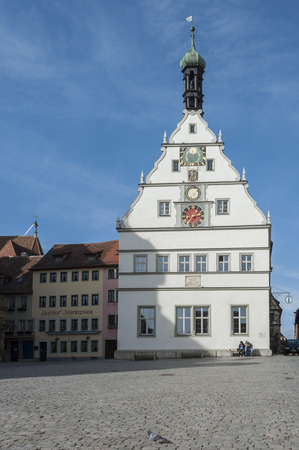 Town Hall (Rathaus) at Marktplatz - the main square of Rothenburg ob der Tauber, one of the most beautiful and romantic villages in Germany - Europe