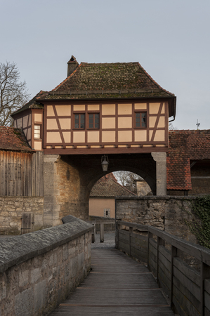 The stronghold gate in the medieval town of Rothenburg ob der Tauber, one of the most beautiful and romantic villages in Europe, Germany, Germany