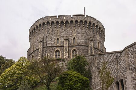 WINDSOR, ENGLAND -MAY, 24 2018: Windsor Castle, built in the 11th Century, is the residence of the British Royal Family at Windsor in the English county of Berkshire, United Kingdom
