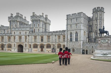 WINDSOR, ENGLAND -MAY, 24 2018: Changing of the guards at Windsor Castle, the residence of the British Royal Family at Windsor in the English county of Berkshire, United Kingdom Publikacyjne