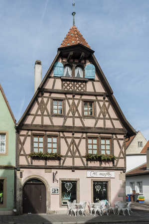 ROTHENBURG OB DER TAUBER, GERMANY - MARCH 05, 2018: Historic colorful half-timbered houses in the medieval town of Rothenburg ob der Tauber, one of the most beautiful villages in Europe, Germany,