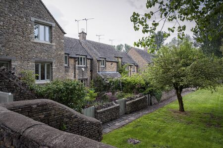 Romantic stone cottages in the lovely Burford village, Cotswolds, Oxfordshire, England Stock Photo