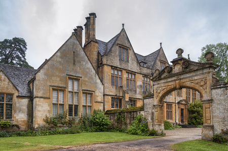 STANWAY, ENGLAND - MAY, 26 2018: Stanway Manor House built in the Jacobean period architecture 1630 in the guiting yellow stone, in the Cotswold village of Stanway, Gloucestershire, Cotswolds, UK Editorial