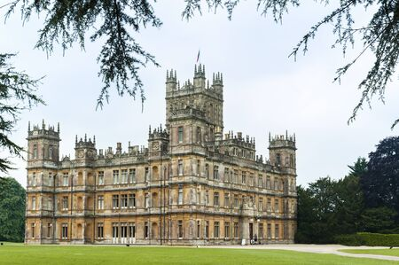 NEWBURY, HAMPSHIRE, ENGLAND - MAY 27 2018: Highclere Castle, at Jacobethan country house style, home of the Earl and Countess of Carnarvon. Setting of Downton Abbey - UK