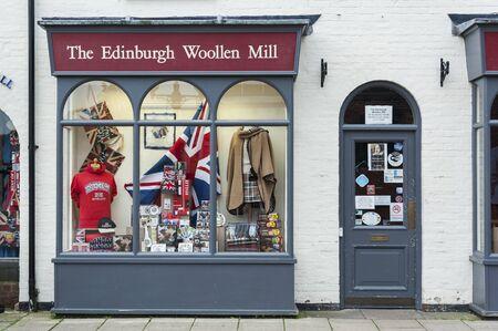 STRATFORD-UPON-AVON, WARWICKSHIRE, UK - MAY 27, 2018: The Edinburgh Wollen Mill Shop in Stratford-upon-Avon, the 16th-century birthplace of William Shakespeare