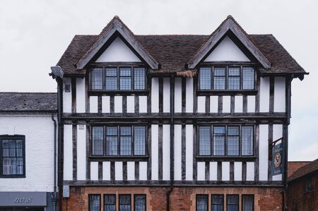 STRATFORD-UPON-AVON, WARWICKSHIRE, UK - MAY 27, 2018: Beautiful houses in Tudor style in the medieval market town Stratford-upon-Avon, the 16th-century birthplace of William Shakespeare Publikacyjne