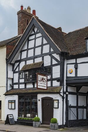 STRATFORD-UPON-AVON, WARWICKSHIRE, UK - MAY 27, 2018: City Center shop in Tudor style in the medieval market town Stratford-upon-Avon, the 16th-century birthplace of William Shakespeare