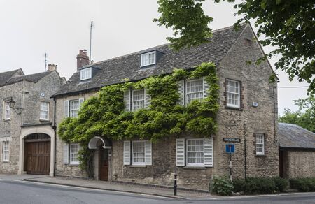 WOODSTOCK, UK - MAY 28, 2018: Wisteria on Thomas Chaucer's House & servants' Cottage in the small town of Woodstock, Park Street - Oxfordshire, England - UK