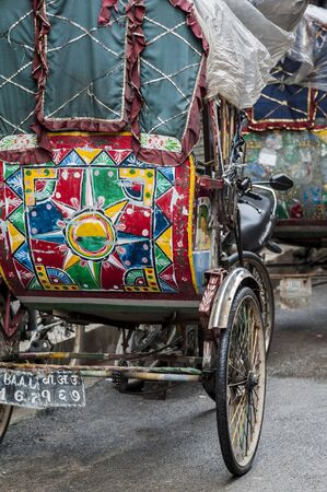 Colorful and tradional nepalese rickshaws waiting for customers in the streets of Thamel district - Kathmandu, Nepal