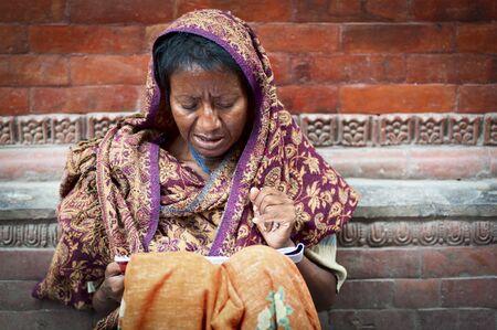 PASHUPATINATH, NEPAL - AUGUST 13, 2018: Hinduist woman, at Pashupatinath Temple, a Hindu temple - Kathmandu, Nepal