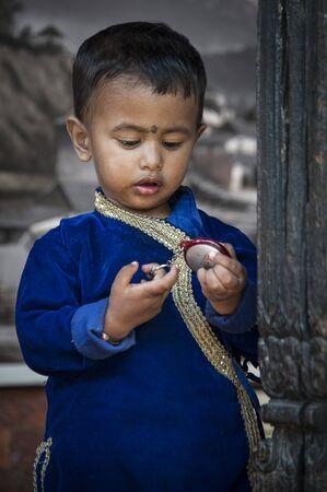 BHAKTAPUR, NEPAL AUGUST 13, 2018: Unidentified Nepalese Newari child playing in Bhaktapur Publikacyjne