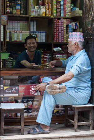 BHAKTAPUR, NEPAL AUGUST 13, 2018: Unidentified Nepalese Newari men in a haberdashery in Bhaktapur