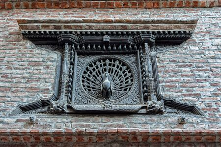 The Peacock Window, an early 15th century latticed window with intricately carved peacock in its center, off Dattatraya Square, Bhaktapur, Nepal