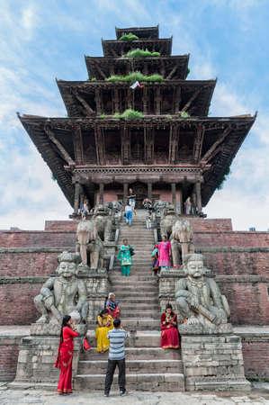 BHAKTAPUR, NEPAL? AUGUST 13, 2018: Unidentified Nepalese newari people in front of the Nyatapola Temple on Taumadhi square - Durbar Square of Bhaktapur, Nepal