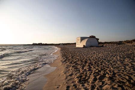 A machinegun nest in Majorca beach, during a summer sunset