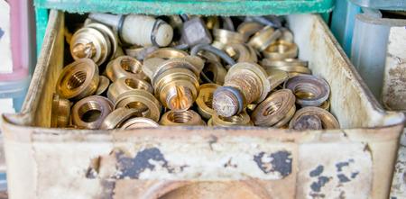 loosen: brass nuts in drawer