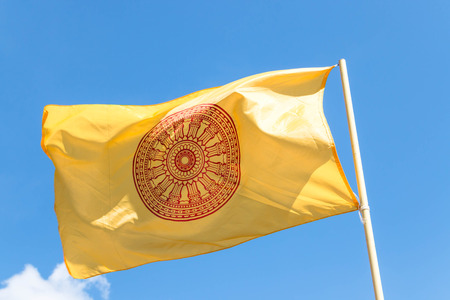 buddhism: flag of Buddhism on blue sky