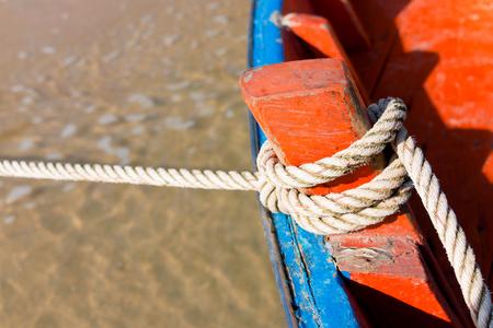 tied: rope tied up wooden boat, unmovable Lizenzfreie Bilder