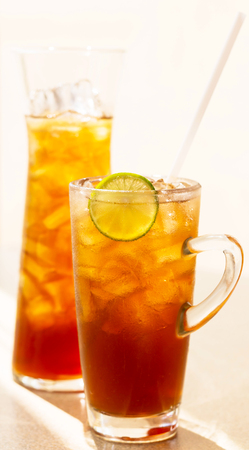 two glasses of lemon ice tea on the table