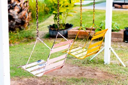 represent: empty swingset represent the loneliness, wait, hope, sad Stock Photo