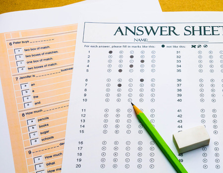 questions and answer sheet for English test on table