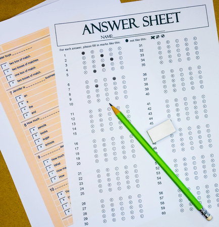 final examination: top view of questions and answer sheet for English test on table