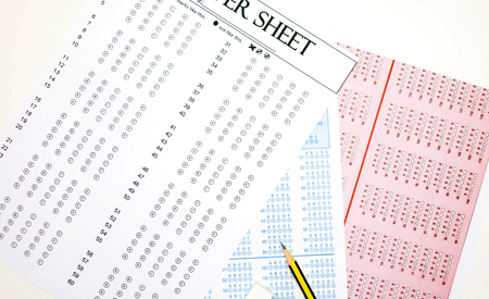 Different Colour Of Blank Answer Sheets On Table Stock Photo
