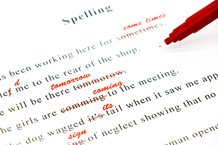 and spelling: red pen marked on wrong spelling and write correct word above