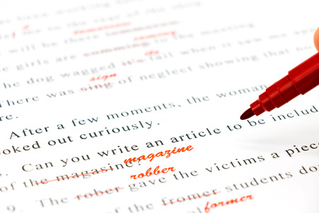 essay: red pen marked on wrong spelling and write correct word above