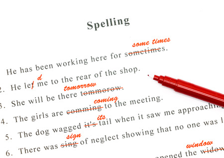 red pen marked on wrong spelling and write correct word above