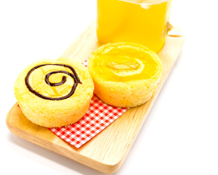butter icing: four soft sweet homemade cupcakes on wooden plate