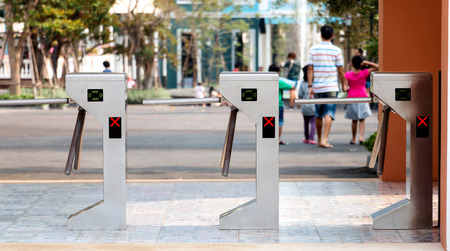 three electronic turnstiles in front of amusement park