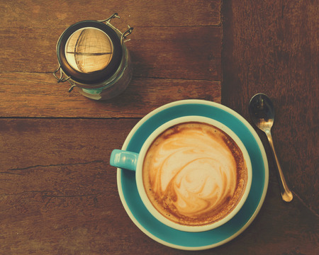 represent: blue cup of coffee on wooden table represent warm feeling Stock Photo