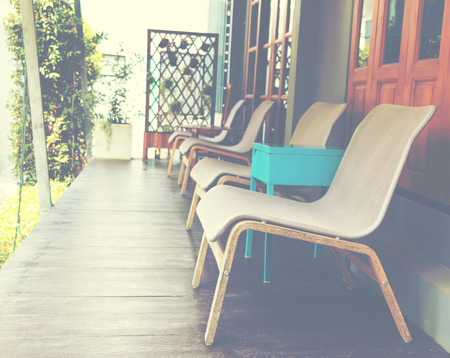 represent: empty chairs in front of room represent relaxing time Stock Photo