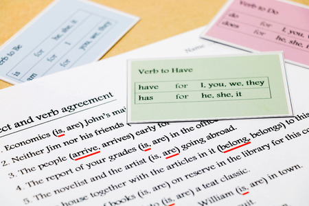 english grammar exercise with grammar cards on table