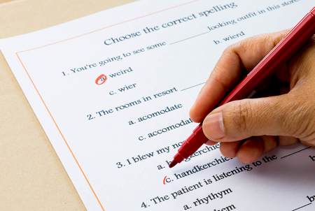 and spelling: red pen marking on multiple choices on english spelling vocabulary test