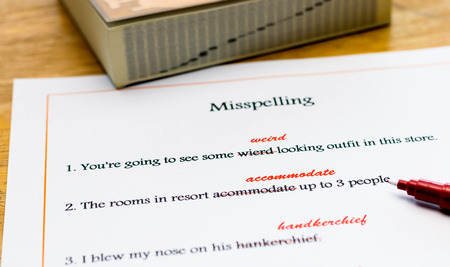 essay: red pen marking on misspelling english words Stock Photo
