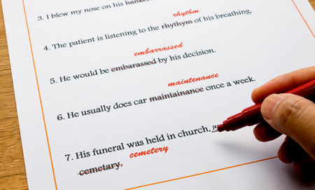 red pen: red pen marking on misspelling english words Stock Photo