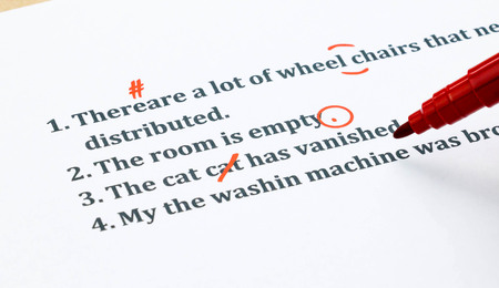 correcting: english sentences and correcting symbols represent proofreading process