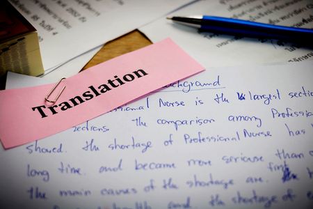 handwriting blue english words on white paper represent translating to English language Banco de Imagens