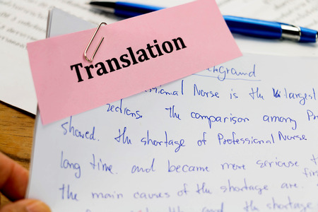 transcribe: handwriting blue english words on white paper represent translating to English language Stock Photo